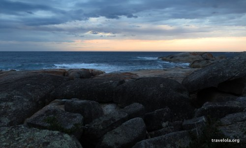 Views looking out over the rocks at dusk in Bicheno