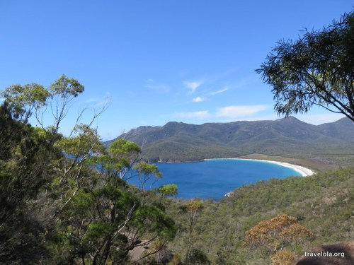 View from lookout down onto bright blue sea of Wineglass Bay